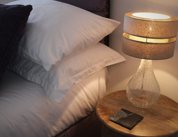 B&B Highland Cow room, bed light standing on a circle table